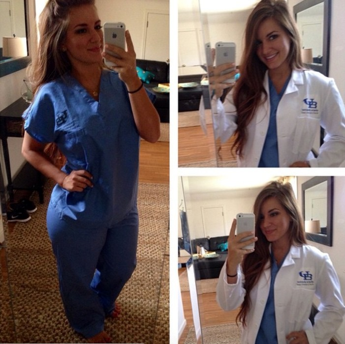 Mindy Sittinpretty posing taking a photo in her medical uniform