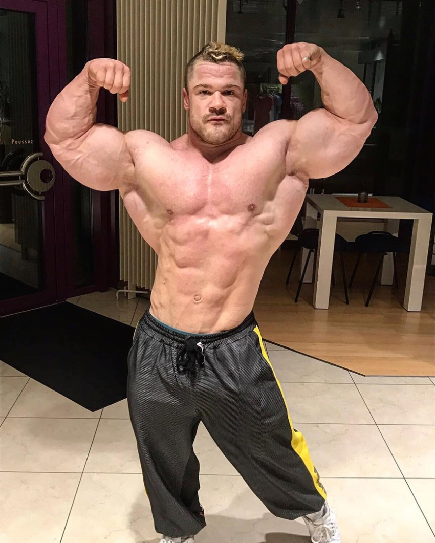 Nicolas Vullioud doing an off-season shirtless front double biceps flex