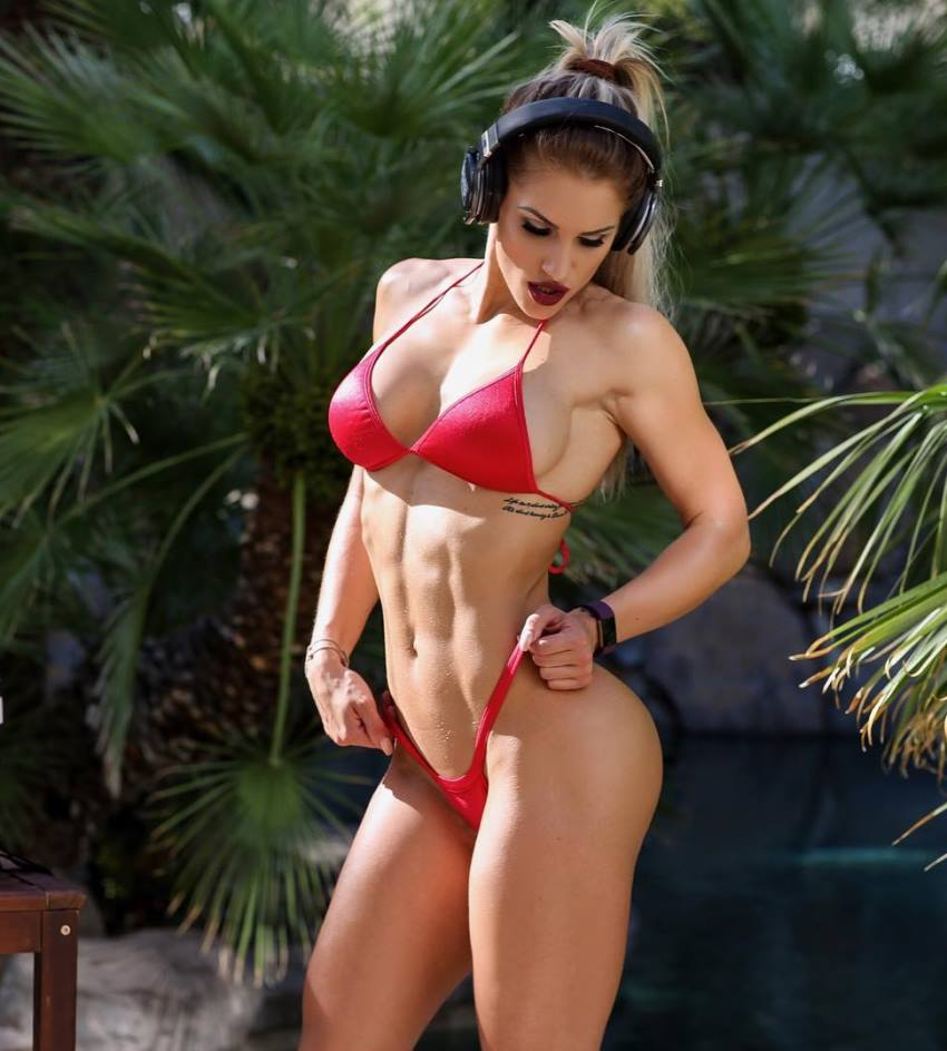 Nikola Weiterova posing in a red bikini looking lean and fit