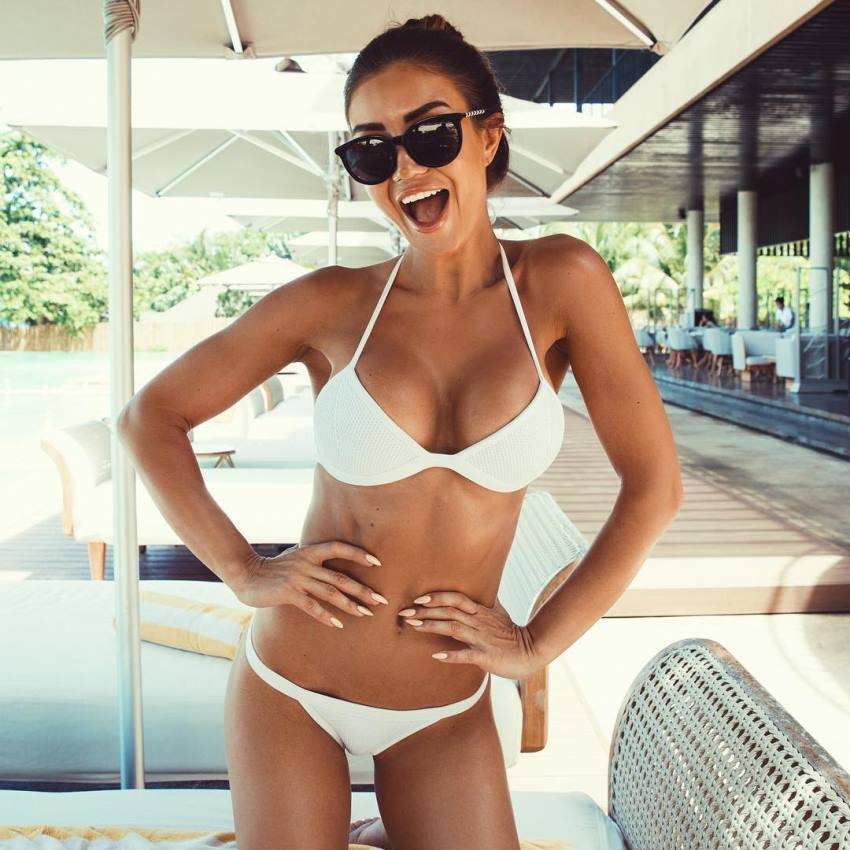Pia Muehlenbeck smiling for the photo looking fit and lean
