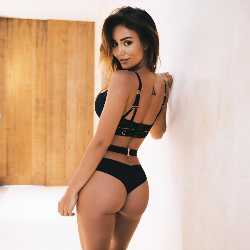 Pia Muehlenbeck posing for a photo in black lingerie looking fit