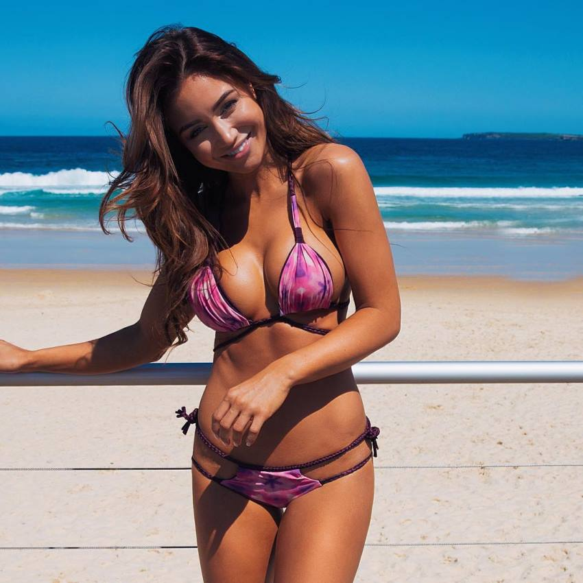 Pia Muehlenbeck standing by the beach smiling for the photo