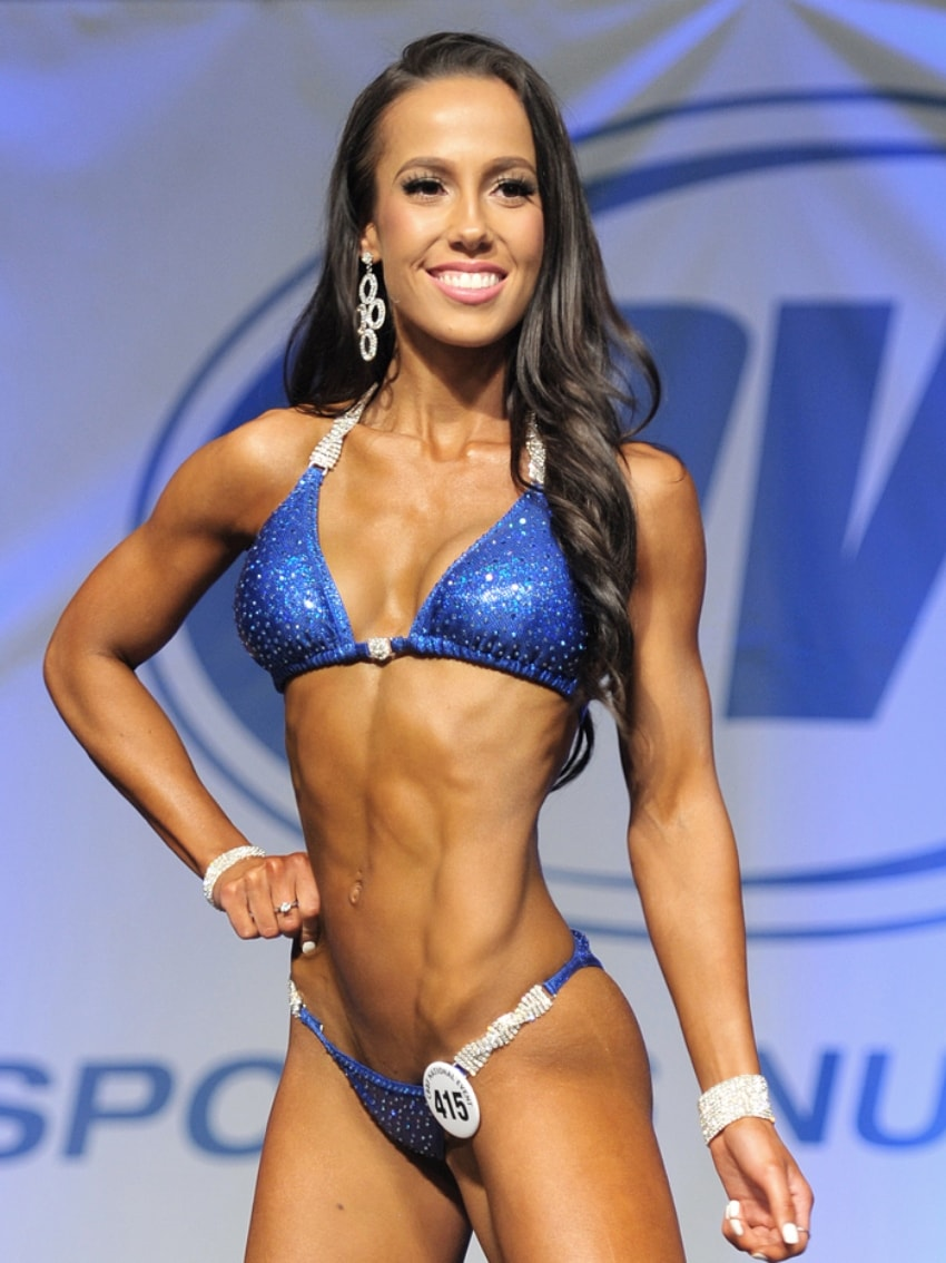 Randi Kennedy posing on the bikini stage, looking fit