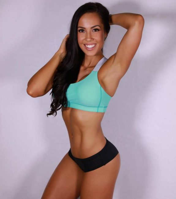 Randi Kennedy smiling for the camera looking fit and lean