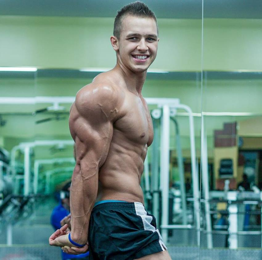 Regan Grimes in a side triceps pose when he was 18 years old