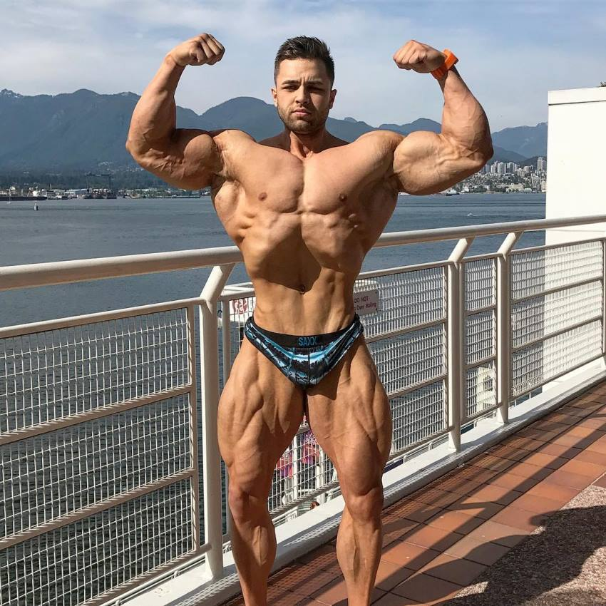 Regan Grimes shirtless outdoors flexing his biceps looking big and vascular