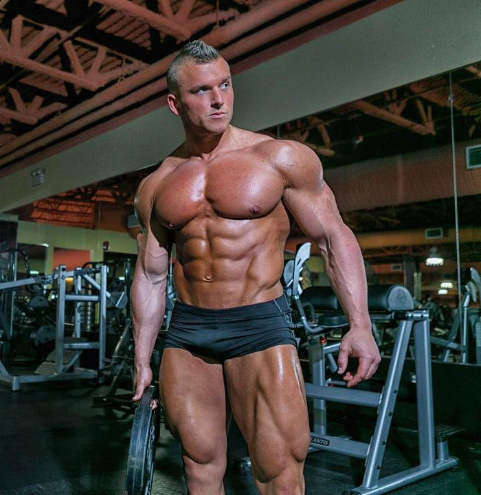 Samuel Dixon posing in a gym photo shoot.