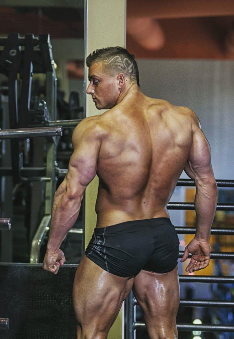 Samuel Dixon showing off his back muscles.