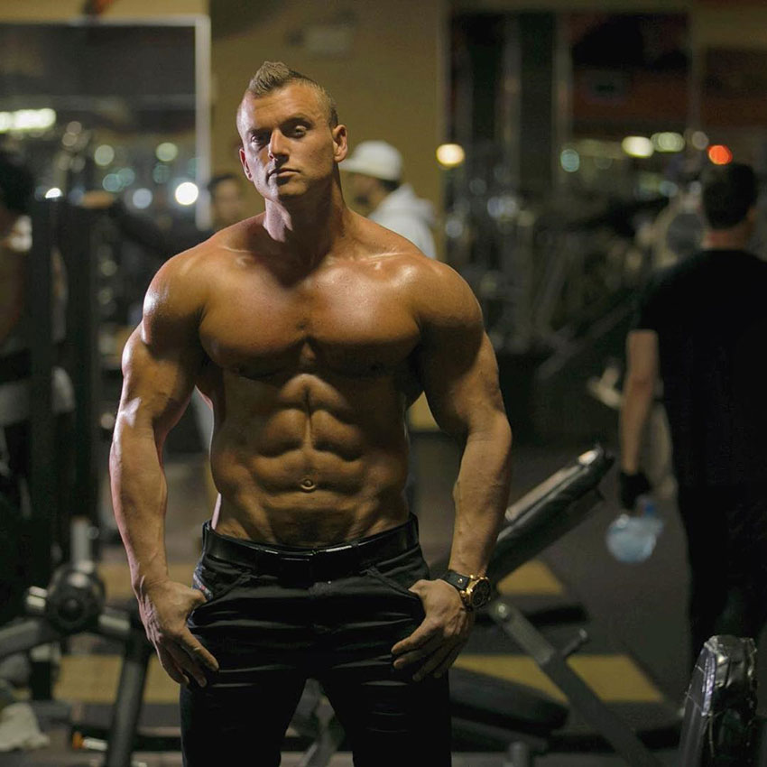 Samuel Dixon posing in the gym in a photo shoot.