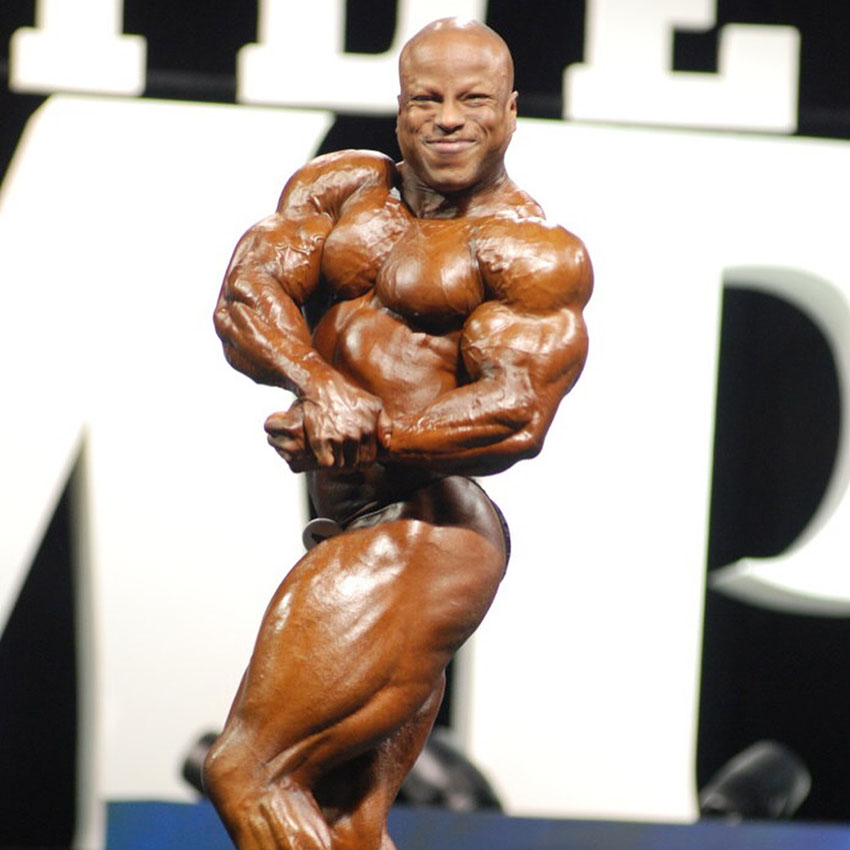 Shaun Clarida flexing on the bodybuilding stage.