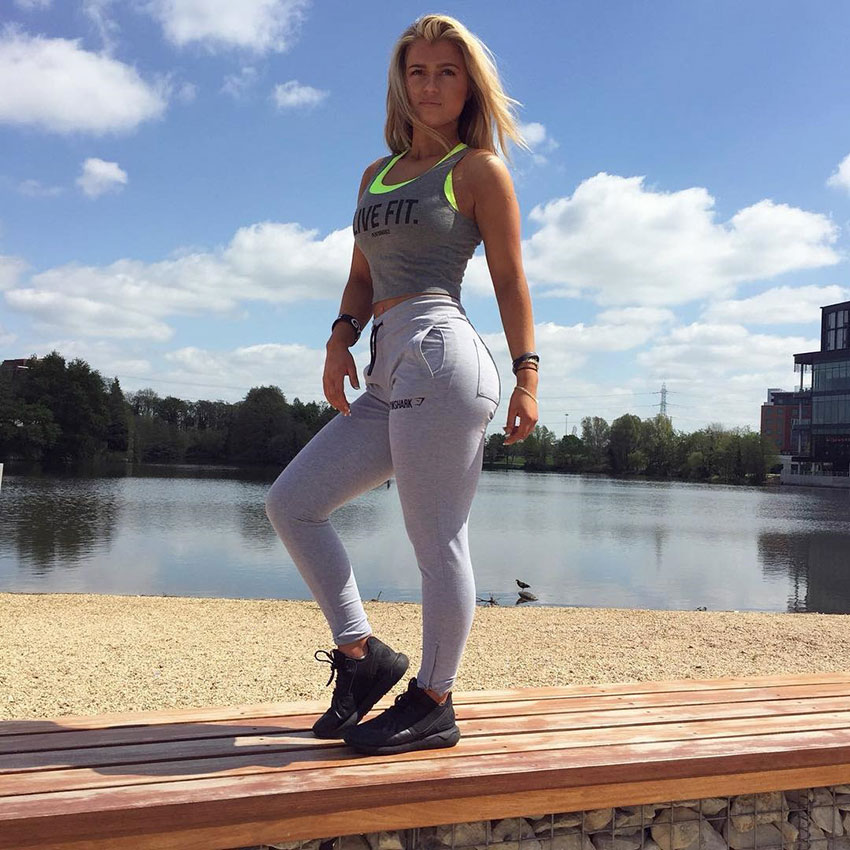 Sian Walton posing by a lake.