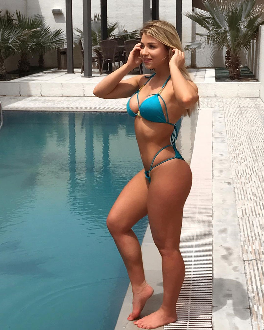 Sophie Aris stood next to a swimming pool.