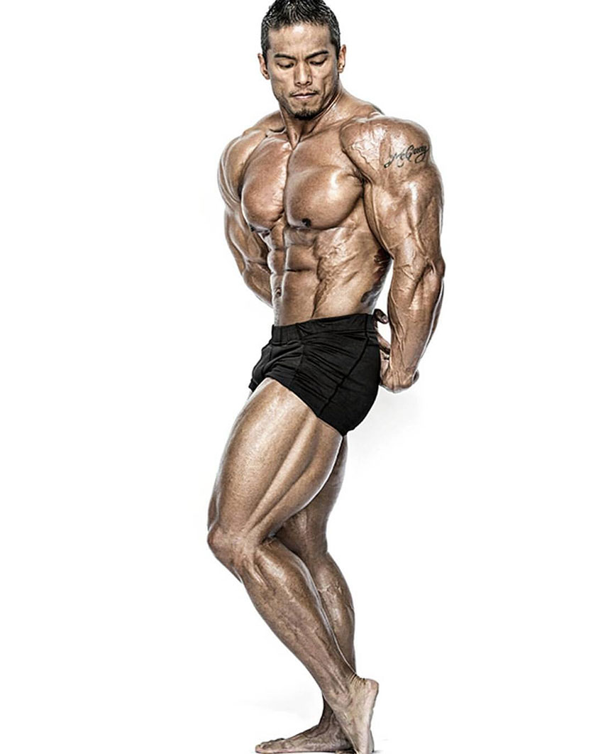 Stan McQuay posing showing off his shredded physique.