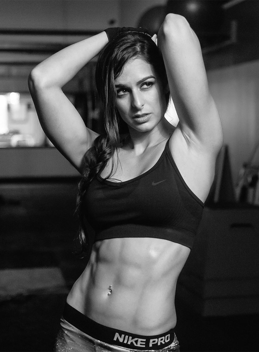 Stephanie Sequeira showing off her abs in a photo shoot.