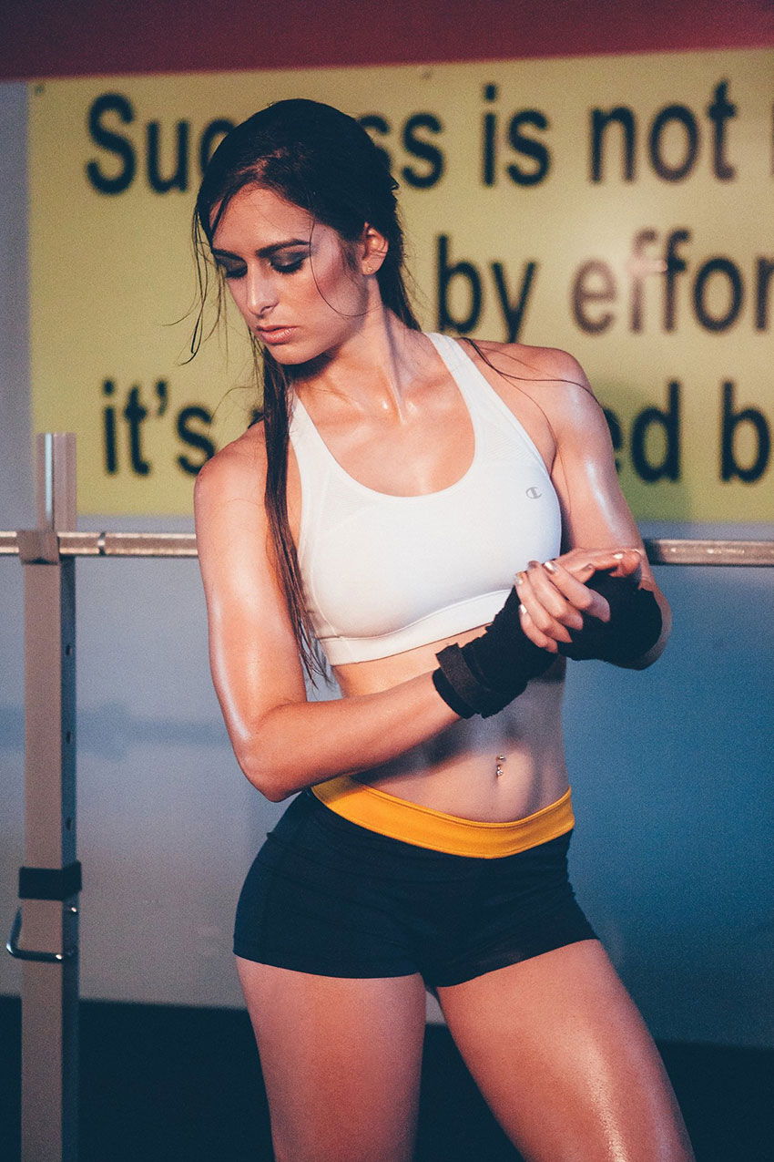 Stephanie Sequeira posing in a photo shoot wearing gloves.