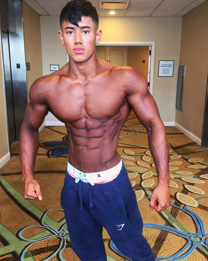 Steven Cao posing tanned up in a hotel lobby