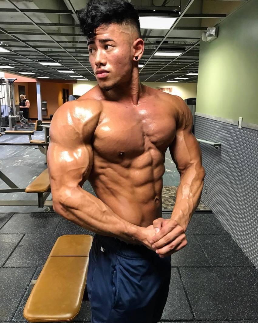 Steven Cao side chest pose flexing shirtless