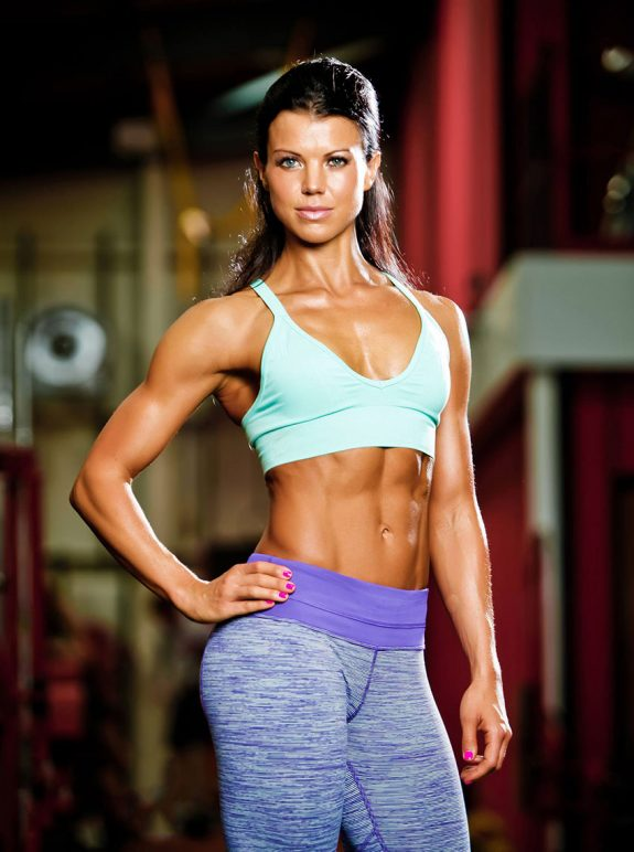 Susie Woffenden showing off her abs in a photo shoot.