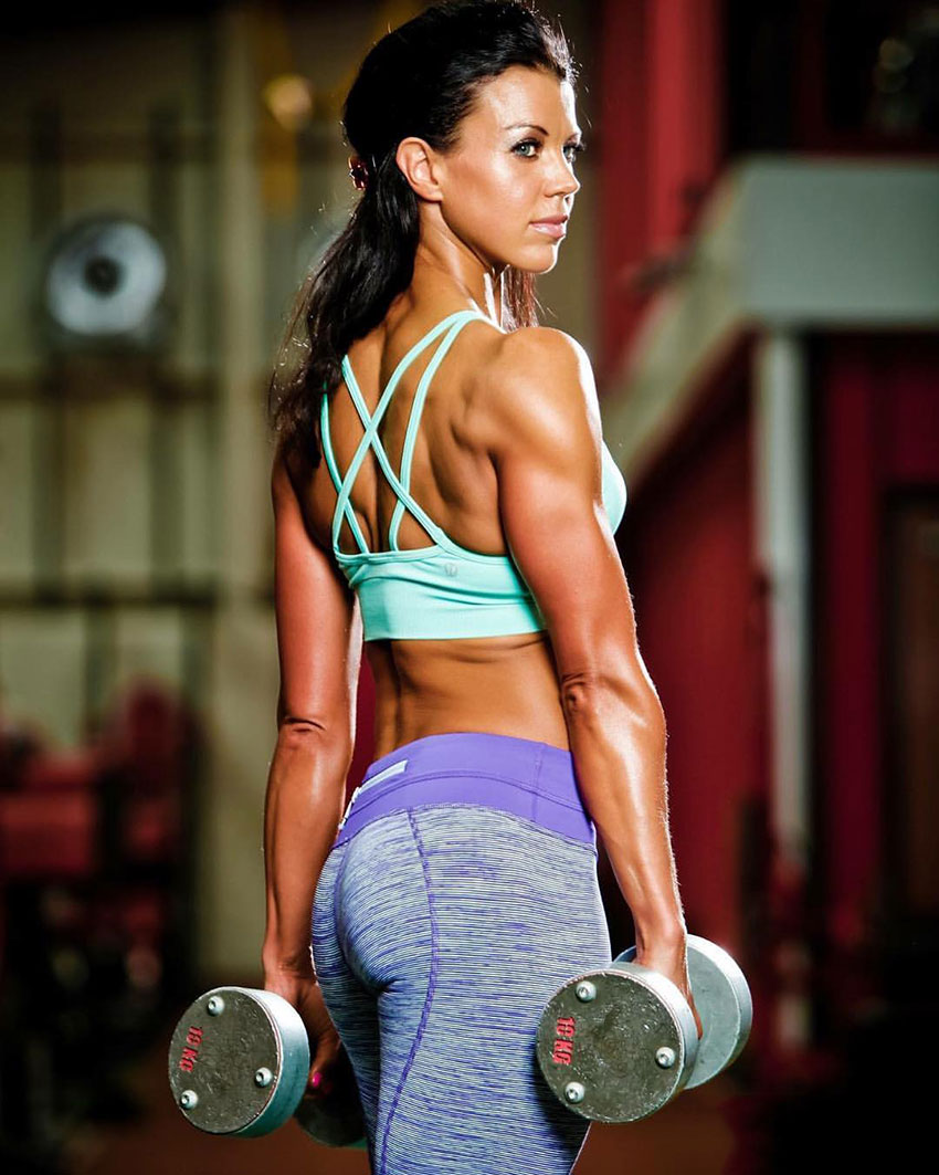 Susie Woffenden holding dumbbells in a photo shoot.