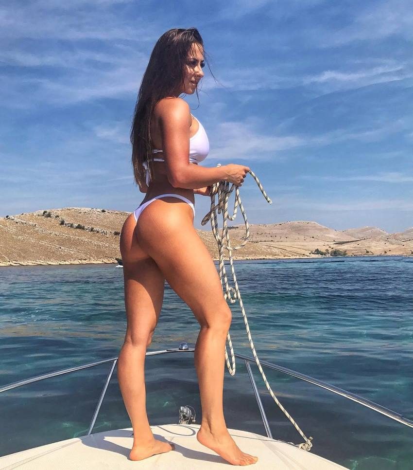 Timea Trajtelova on the boat enjoying the sun, her glutes and legs looking awesome
