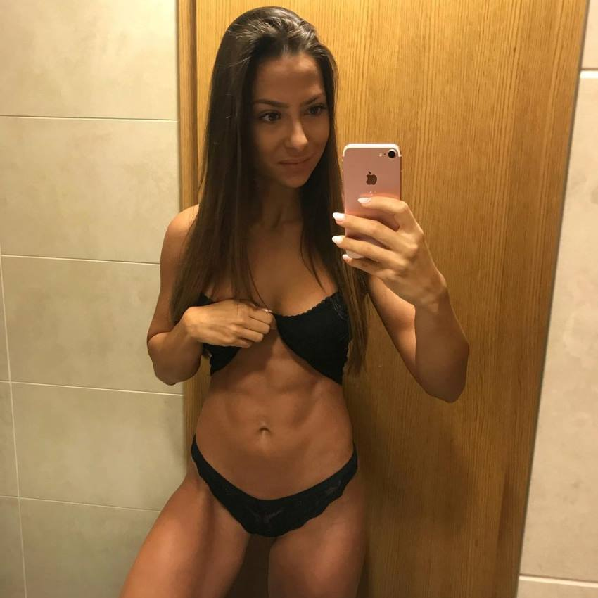 Timea Trajtelova taking a selfie of her ripped abs