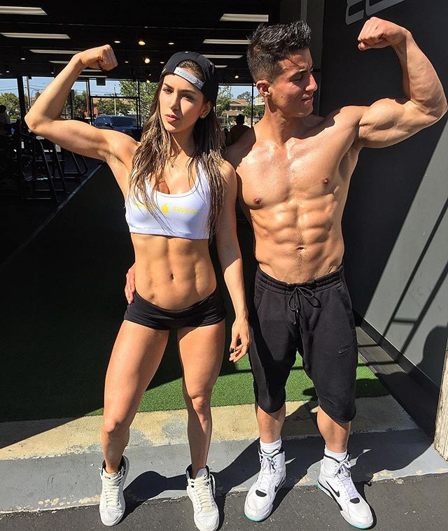 Tomas Echavarria flexing his biceps with his partner Anllela Sagra
