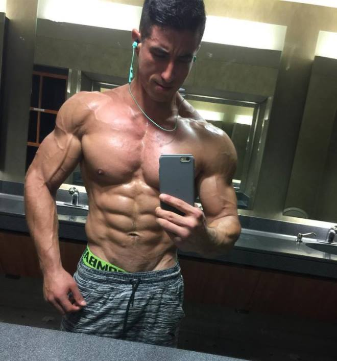 Tomas Echavarria taking a selfie of his ripped physique