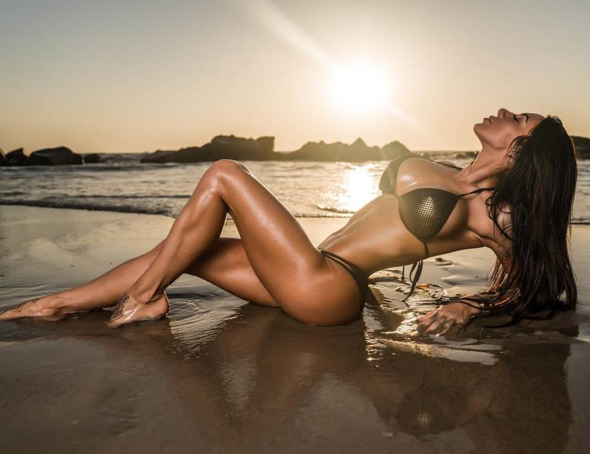 Venessa Nieto lying on a shore looking fit and lean