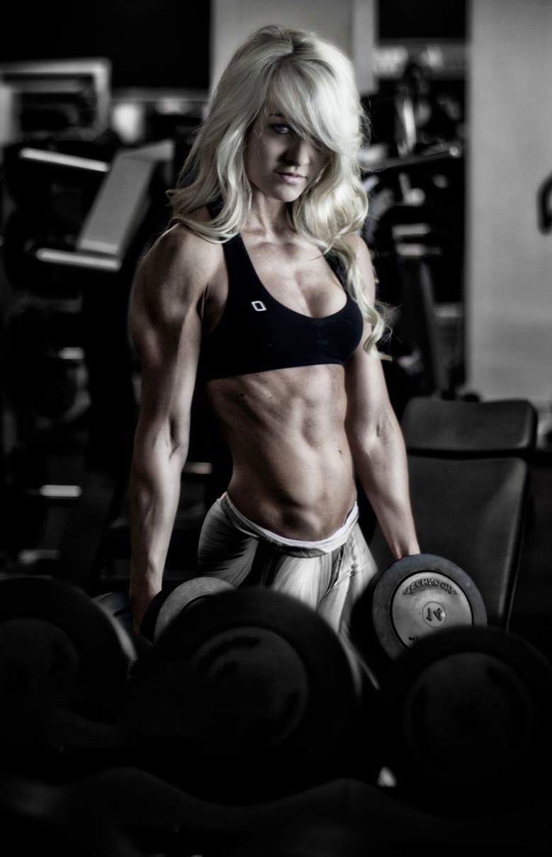 Zoe Daly holding dumbbells in a photo shoot.