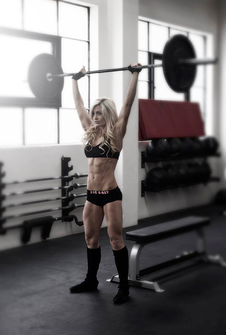 Zoe Daly peforming barbell military presses.