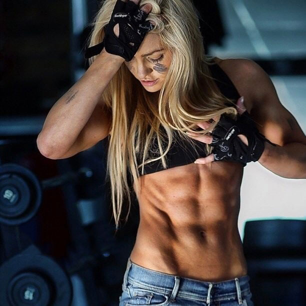 Zoe Daly showing off her lean, sculpted abs.