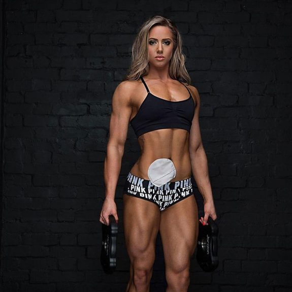 Zoey Wright holding kettlebells in a photo shoot.