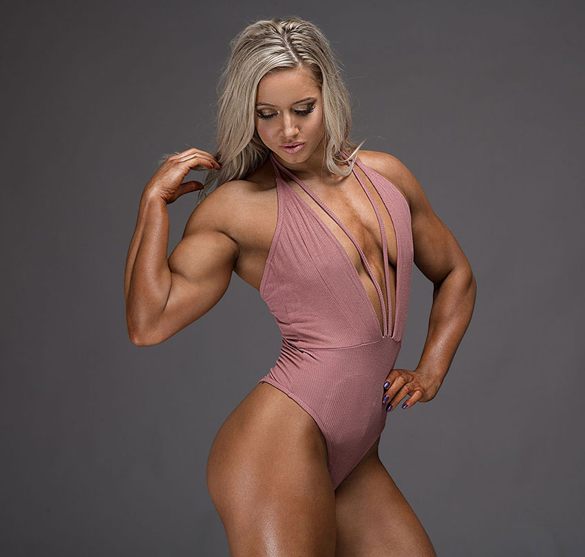 Zoey Wright flexing her arm in a photo shoot.