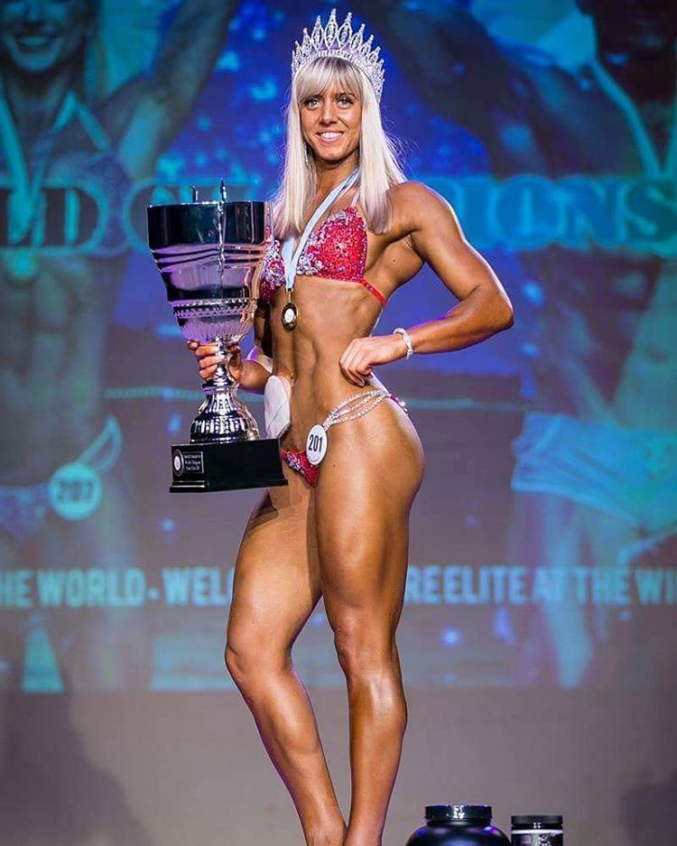 Zoey Wright on stage after winning a competition.