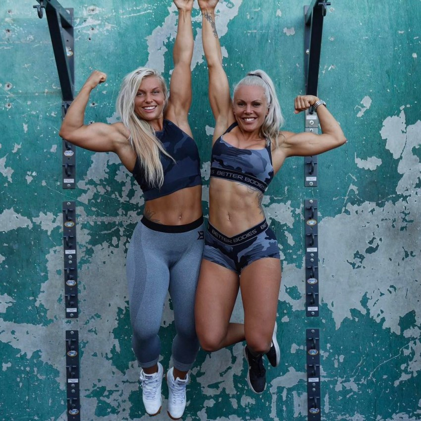 Anna Stålnacke hanging on the bar alongside Caroline Aspenskog, her friend and workout partner