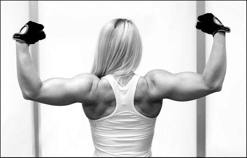 Ashley Lockaby flexing her biceps.