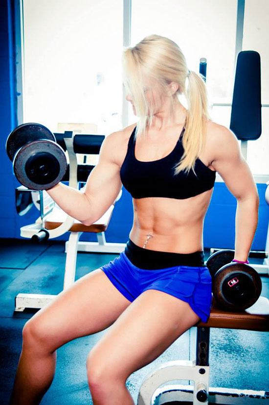 Ashley Lockaby exercising with dumbbells.