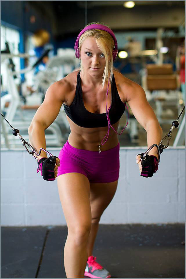 Ashley Lockaby exercising in the gym with cables.