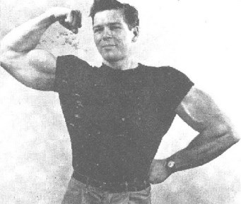 Bruce Randall flexing his biceps