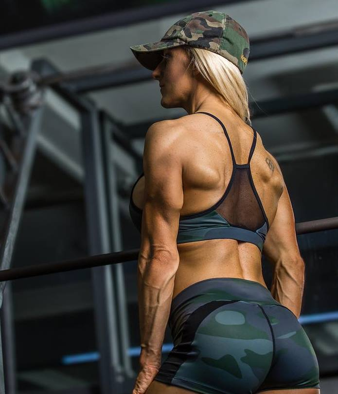 Clare Taubman showcasting her back muscles for a photo