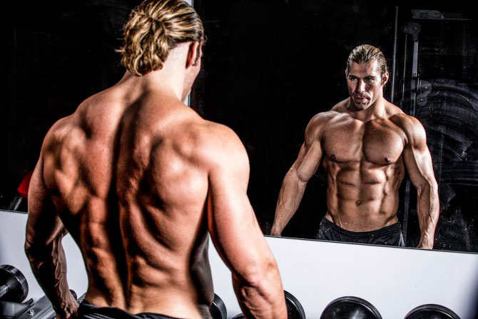 Craig Capurso looking into the mirror in a photo shoot.
