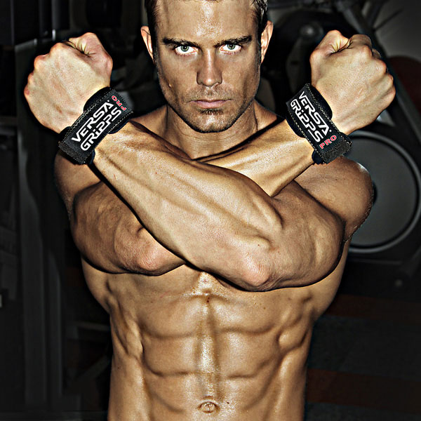 David Kimmerle crossing his arms showing off his shredded body.