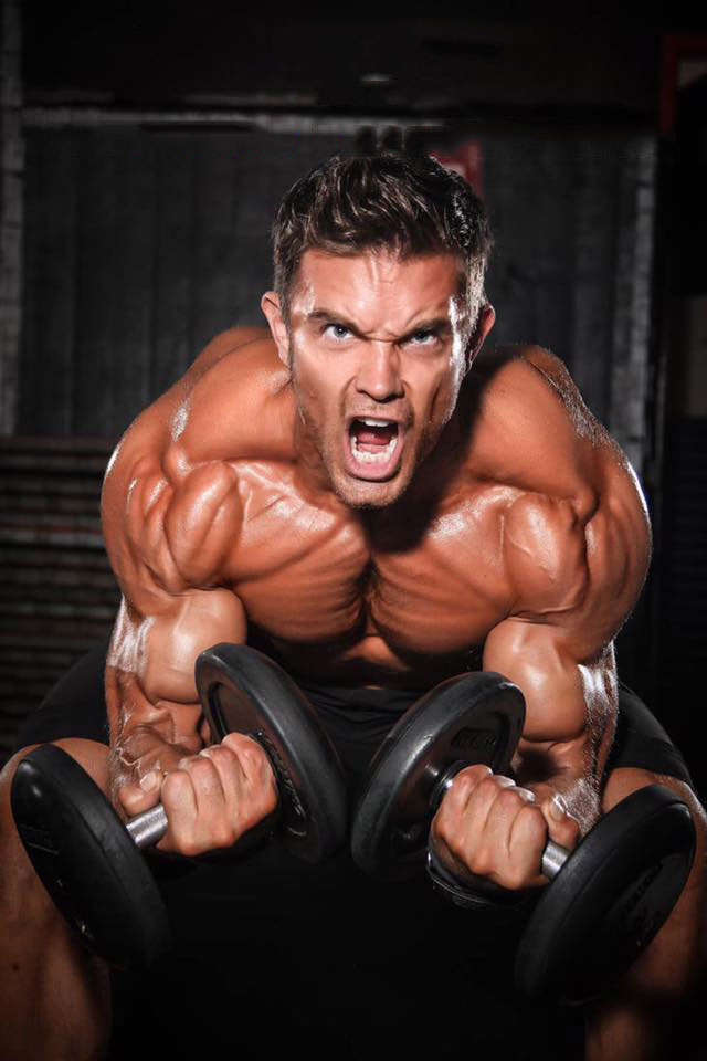 David Kimmerle holding dumbbells in a photo shoot.