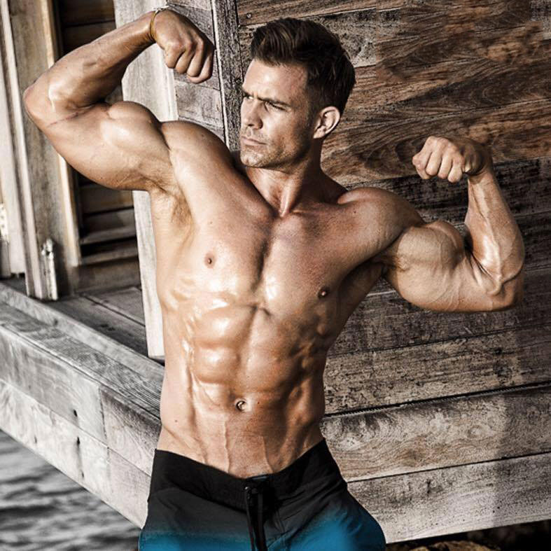 David Kimmerle flexing his biceps for a photo shoot.