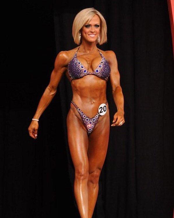 Gennifer Strobo posing on the bodybuilding stage.