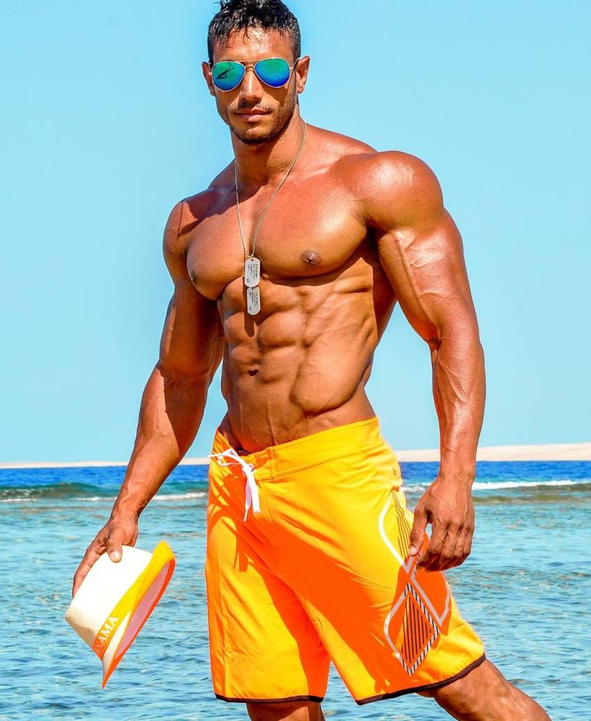 Hany Saeed posing by the sea looking ripped and aesthetic