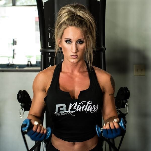 Hope Trask performing cable curls.