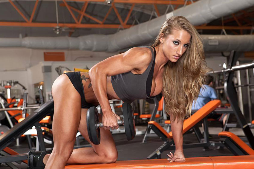 Hope Trask performing dumbbell rows.