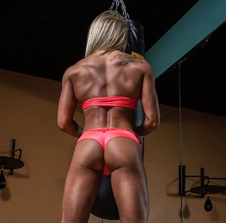 Hope Trask showing off her glutes, back, and leg muscles in the gym.