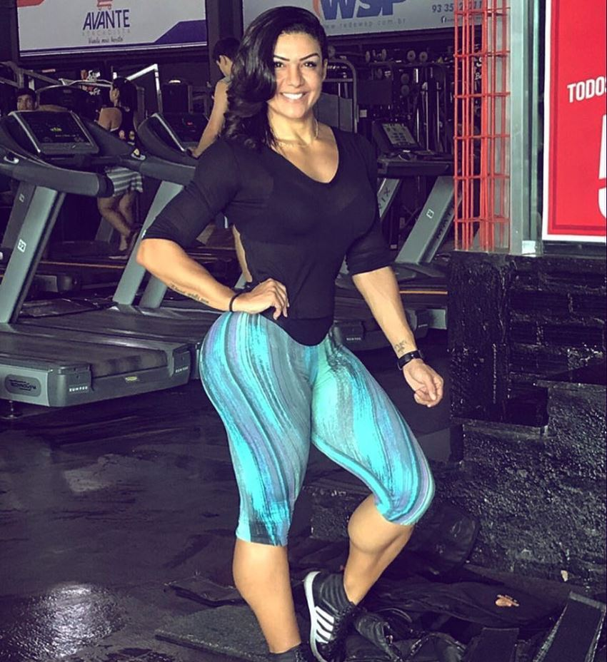 July Jardim standing in a gym and smiling for a photo